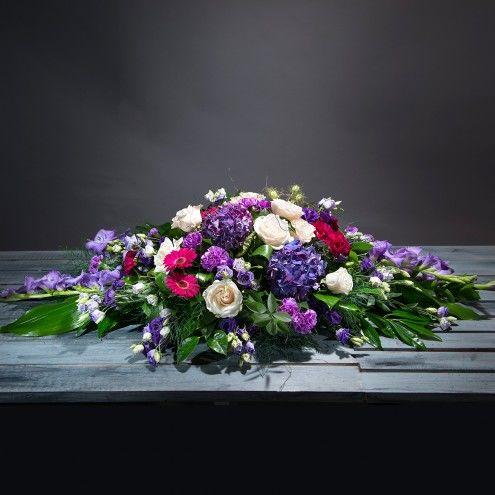 Almohadón de flores moradas