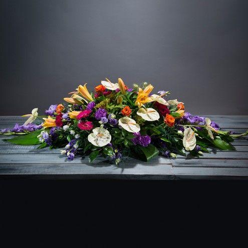 Almohadón de flores multicolores