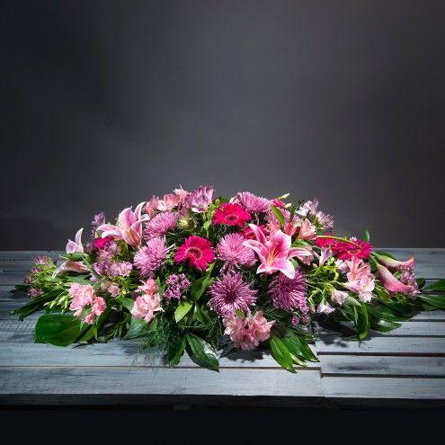 Almohadón de flores rosas